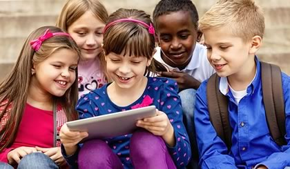 School kids in Education playing on iPad